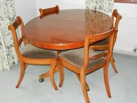 High quality solid Yew wood extending tining table and four upholstered chairs