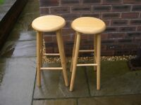Two identical pine stools.
