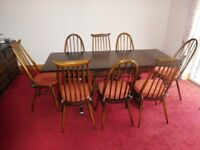 ERCOL darkwood dining room table and eight chairs with cushions