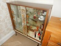 1960,s China Cabinet with glass front and mirrored centre panel and rear interior. Good condition
