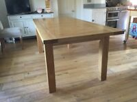 Large 8 seater dining table extending to 12 seater