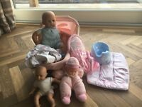 3 Dolls including carry cot, sling and other accessories