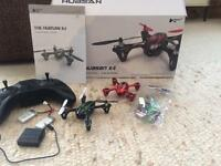 Hubsan x4 drone with extra shell and two batteries packs and charging dock