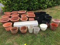 Various used plastic plant pots and tubs