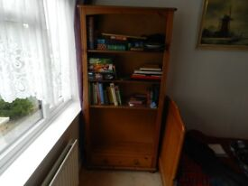 Pine bookshelf with one drawer at the bottom.