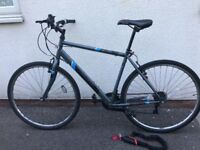 Excellent hybride bicycle including strong cycle lock, lights and 1 year bike care plan at Halfords!
