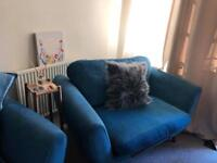 Three seater and a snuggle chair