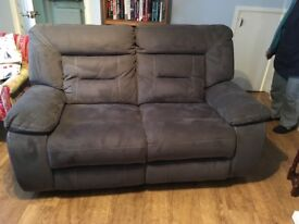 2 Grey seater recliner.