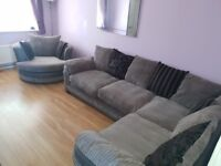 Steel and Black DFS corner sofa and large swivel cuddle chair