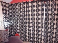 3 sets of curtains, black and cream spirals