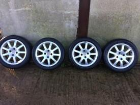 Four alloy rims and tyres for sale