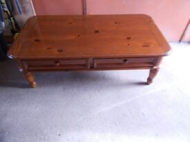 """Light mahogany wood coffee table 50 inch length by 27"""" inch wide. Good condition."""