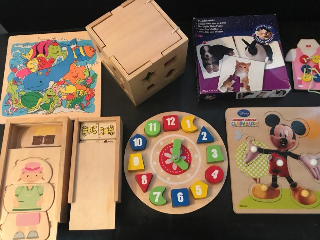 Selection of toddler wooden jigsaws/games.