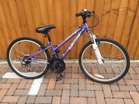Apollo xc 24 girls bike with Dunlop helmet - virtually unused a couple of scratches