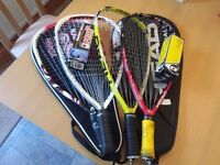 Racketball racquets with cases and balls