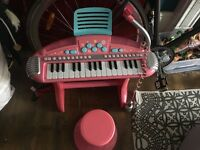 Children's pink piano and stool