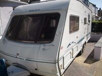 4 BIRTH SWIFT CHALLENGER 560 SAL TWIN WHEELBASE LUXURY TOURING CARAVAN ,LOADS OF EXTRAS,STARTER KIT