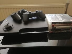 PlayStation 3, 2 controller's and games.