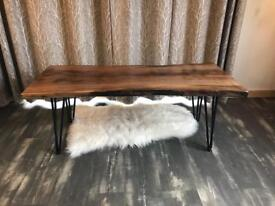 Live edge walnut coffee table with LED underlighting.