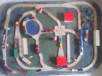 Brio wooden train set with accessories on a board