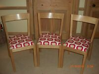 Three Dining chairs recently upholstered in an easy keep clean material