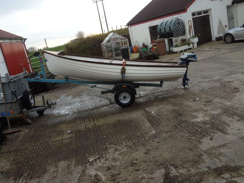 12ft boat trailer,engine oarsin Randalstown, County AntrimGumtree - Fiberglass clinker style boat ,trailer new hubs,bearings ,tyres,rims,mudguards oars all new ,engine can be seen running ready for the season please only phone if intrested will sell engine seperate