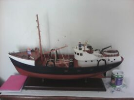 Model fishing boat on stand 30inches long