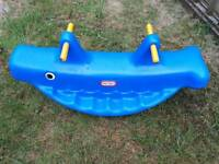Little tikes whale shaped see saw.