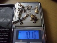 4 NEW PENDANTS 1 is a 14k gold turtle also a silver frog on a silver chain, also two silver crosses