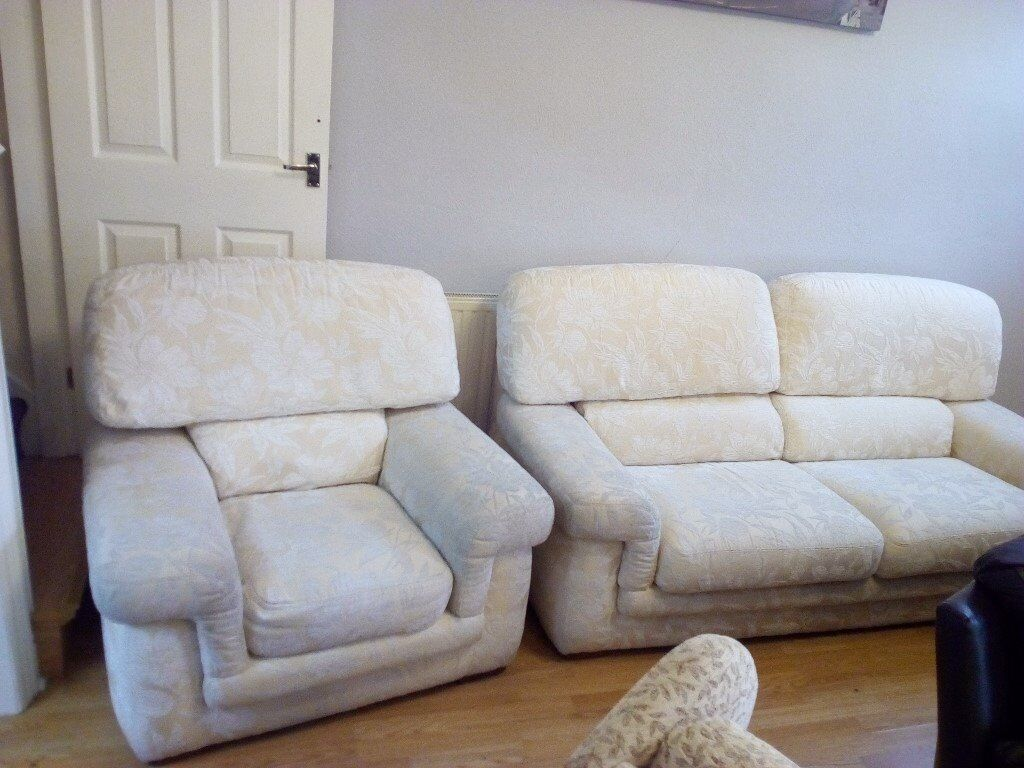 Large cream 2 seater sofa and chair. Good quality solid with no wear or tears