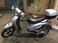 Piaggio Liberty 125 for sale with colour coded top box and tall screen, Michelin tyre