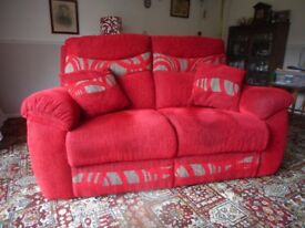 Two seat settee with cushions