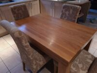 Oak table and 4 beige high back chairs