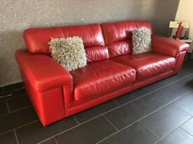 Red leather 4 seater couch and foot stool