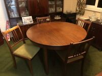 Round extendable teak table and 6 chairs