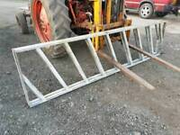 Two ten foot cattle feed barriers in very good condition tractor
