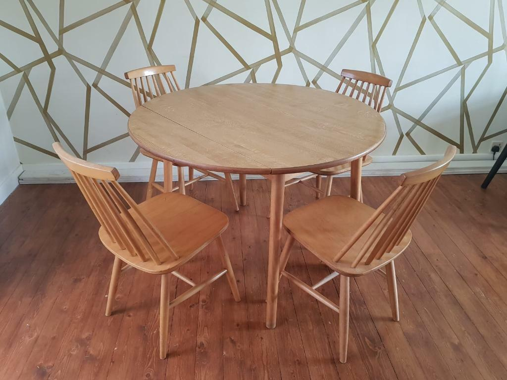 Round Dining Table With Folding Sides Plus 4 Chairs