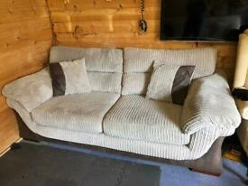 2 cream sofas with foot stall