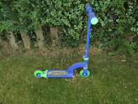 Childrens First Scooter, which has two wheels and folds away