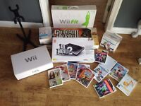 Nintendo Wii Console Bundle, Guitar Heros, Wii Fit Board, DJ Hero and lots of Games