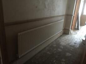 16 radiators of various sizes