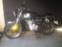 Practically brand new CPI sprint cafe racer 125 cc just 12.3 miles on the clock from new.