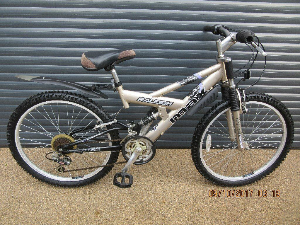 CHILDS RALEIGH MAX DUAL SUSPENSION BIKE IN EXCELLENT LITTLE USED CONDITION. (SUIT APPROX AGE 8 / 9+)