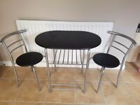 £30 Excellent condition compact table with 2 chairs