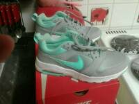 Nike trainers / and diamante flats