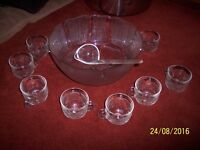 Punch bowl and 8 glasses and leadle.