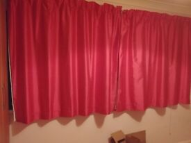 Pair of pink lined curtains.