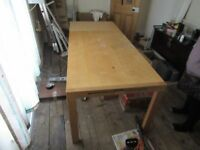 A large Beech wooden table in good condition