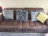 Free leather sofa. Signs of wear and tear.