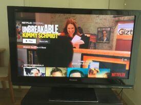 Panasonic 50 inch HD TV (with tv table)